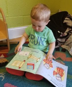 infant reading book